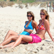 Stock Photo: Two young attractive women chilling in sun on holiday or vac