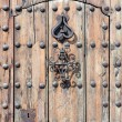 Ancient and antique heavy wooden door — Stock Photo