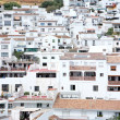 Busy, compact town or Pueblo of Mijas in Spain - Stock Photo