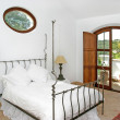 Rustic, white, bright interior of bedroom in Spanish villa — Stock Photo