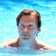 Handsome middle aged man swimming in outdoor pool — Stock Photo #6228660