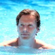 Handsome middle aged man swimming in outdoor pool — Stock Photo