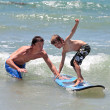 Father teaching his young son to surf — Stock Photo #6229704