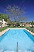 Sunny, luxury swimming pool in Spain — Stock Photo