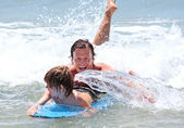 Young father and son learning to surf — Stock Photo