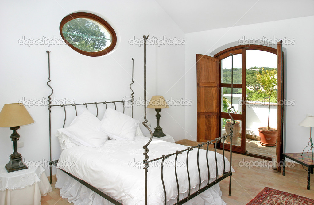 ... bright interior of bedroom in Spanish villa — Stock Image #6227762
