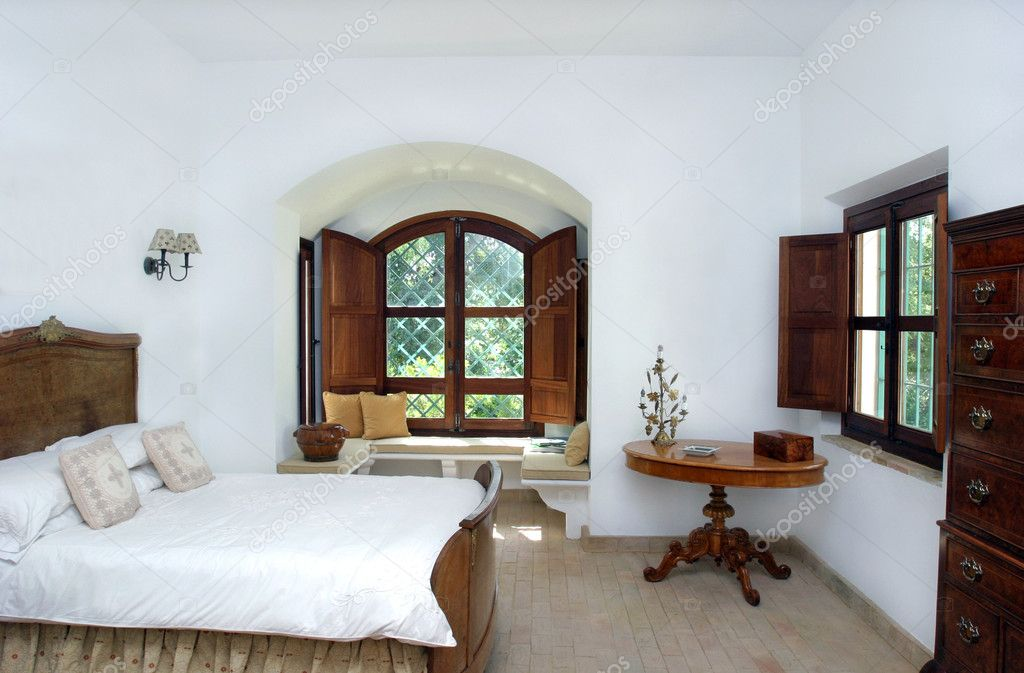 Rustic white bright interior of bedroom in spanish villa for Spanish villa interior design
