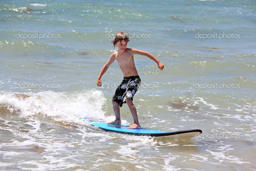 Healthy young boy learning to surf � Stock Photo � freefly #6229834