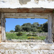 Stock Photo: Spanish countryside seen through hole in wall of ruins