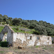 Stock Photo: Spanish countryside next to ruins of building