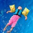 Girl toddler floating on top of swimming pool — Stock Photo