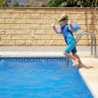 Royalty-Free Stock Photo: Young boy jumping into swimming pool
