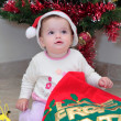 Girl toddler opening Christmas Presents — Stock Photo #6232193
