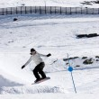 Man snowboarding on slopes of Prodollano ski resort in Spain — Stock Photo