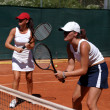 Two fit, young, healthy women playing doubles at tennis in the s — Stock Photo #6232710