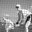 Woman tennis players looking at camera through net waiting to pl — Stock Photo