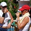 Stock Photo: Two young, fit, healthy, tanned women having drink after hot