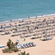 Aerial view of beach and holidaymakers on vacation — Stock Photo
