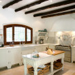 Kitchen interior of large spanish villa. With wooden rafters on — Stock Photo