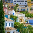 Stock Photo: Colorful Spanish pueblo on hillside