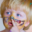 Young boy covered in face paint — Stock Photo #6233304