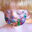 Young toddler covered in face paint — Stock Photo