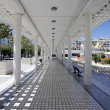 Four long converging lines from inside walkway in modern squar — Stock Photo #6233490