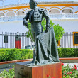 Statue of bullfighter outside bullring in Seville Spain - Stock Photo