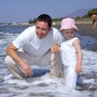 Father and Daughter playing in the sea — Stock Photo
