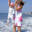 Young mother and daughter playing in the sea — Stock Photo