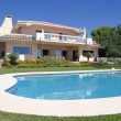 Stock Photo: Luxury swimming pool and exterior of villin Spain