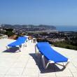 Two blue sunbeds on terrace in the sun with amazing views of the — Stock Photo