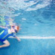 Child or young boy holding breath underwater — Stok fotoğraf #6234211