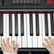 Young boys hands on an electronic piano or keyboard — Stock Photo