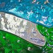 Green blue and white colours of a stained glass window - Stock Photo