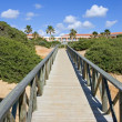 Wooden walkway on sandy beach in Spain — Stock Photo