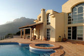 Stunning exterior of luxury villa and swimming pool in Spain — Stock Photo