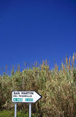 Spanish roadsign next to reeds and bullrushes in Spain — Stock Photo