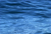 Beautiful calm ripples on deep blue ocean on a bright sunny day — Stock Photo