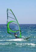 Windsurfer on sunny Tarifa beach in southern Spain — Stock Photo