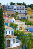 Colorful Spanish pueblo on hillside — Stock Photo
