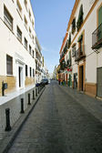 Old deserted street of houses and apartment in Seville Andalucia — Stock Photo