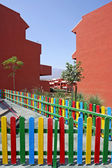 Colourful fence of childrens playground in Spanish vacation apar — Stock Photo