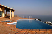 Luxury infinity swimming pool in villa in spain with incredible — Stock Photo