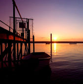Old Rowing Boaton Sea During Sunset — Stock Photo