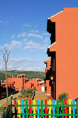 Salmon or orange apartments on Spanish urbanisation — Stock Photo
