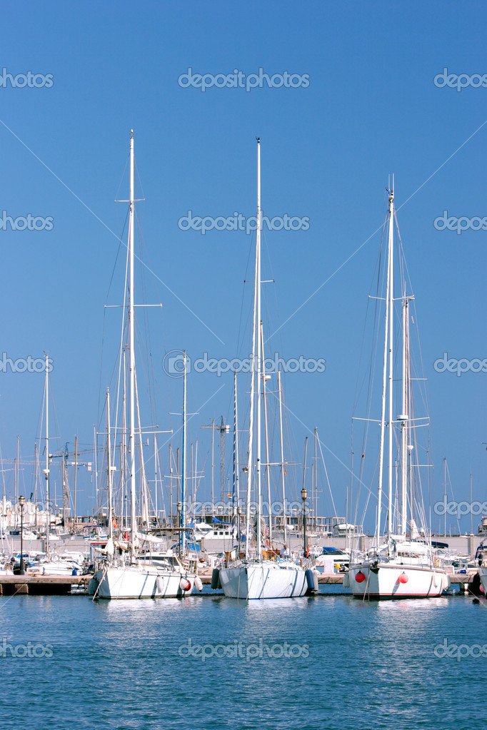 Three tall white sailing ships moored in sunny port or harbour in Spain with sails down and large masts — Stock Photo #6232218