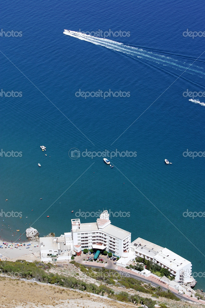 Aerial view of beach and hotel on Gibraltar with yachts sailing past — Stock Photo #6233018