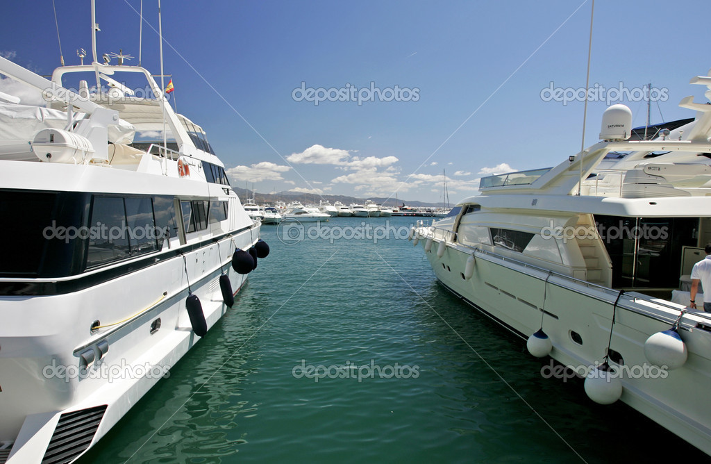 Big, beautiful, stunning and luxurious white yachts moored in harbour or port in Spain on a sunny day. — Stock Photo #6233432