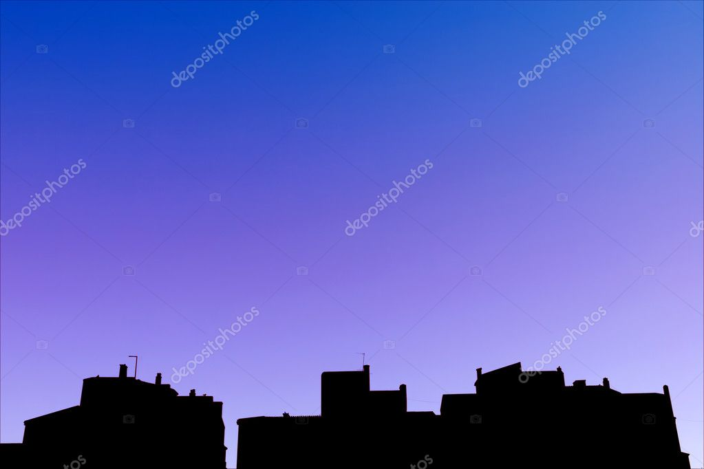 Silhouetted night skyline of rows of white pueblo apartment blocks in Spain  Stock Photo #6234744